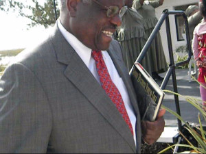 "Justice Thomas with the book, ""Shout Because You're Free."""